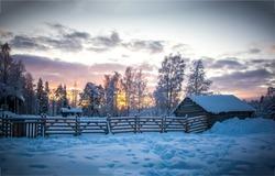 Winter snow village in morning. Snowy winter village at sunrise. Sunrise winter village snow. Winter snow sunrise scene
