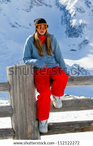 Winter, snowboarding - portrait of young snowboarder girl
