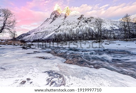 Winter snowy mountain river valley landscape. Wintry mountain river valley landscape. Winter river valley in mountains. Winter snow river in mountains