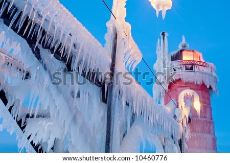 Winter, South Haven, Michigan Lighthouse and catwalk encased in ice at dawn, Lake Michigan, USA