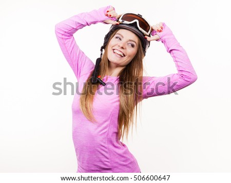 Winter sport hobby people concept. Woman with sporty helmet. Young lady wearing pink clothing. #506600647