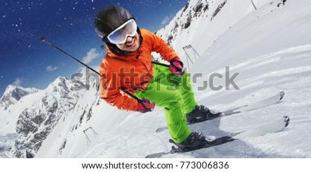 Winter Sport. Skier in mountains.