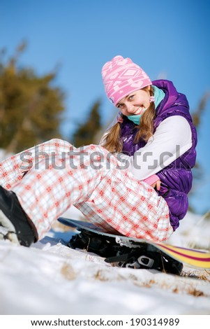 Winter sport, snowboarding - portrait of young snowboarder girl