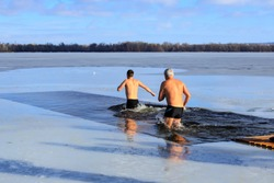Winter sports, Hardening. People swimming in the river holes in winter.  Orthodox holiday of Epiphany, Dnipro city, Dnepropetrovsk, Ukraine
