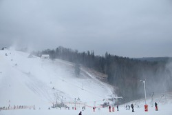 Winter. Sports winter season. Cesis. Latvia. Europe. Picture of of ski hill. Just another day skiing in the mountain.