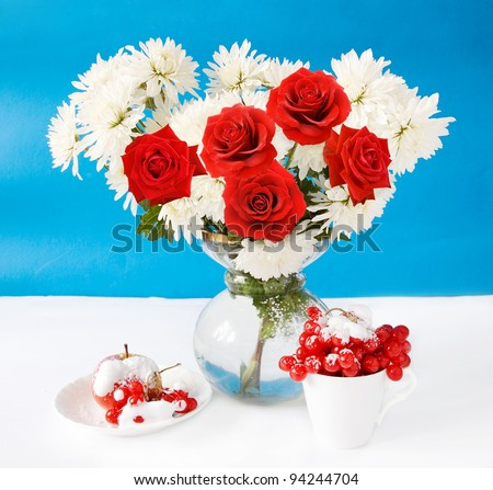 Winter still life with huge bunch of white asters and red roses, apple, viburnum and snow