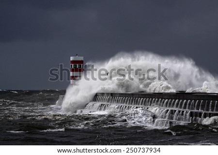 Winter storm with big waves and dark sky at the mouth of the River Douro, Porto, Portugal