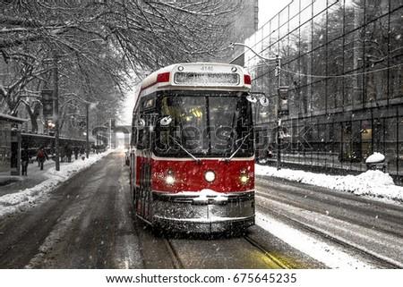 Winter Streetcar Toronto on Queen Street