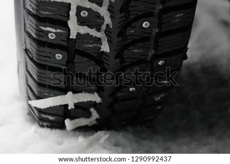 Winter studded tire in the snow