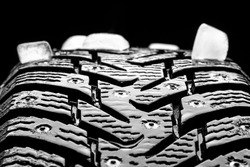 winter studded tyre decorated ice bricks. studio shot. tyres industry concept. copy space.
