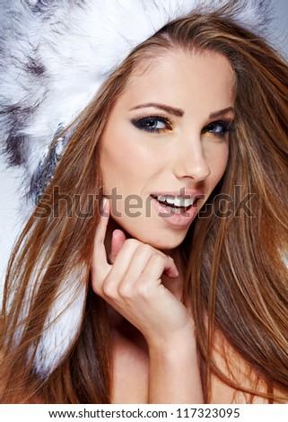 Winter studio portrait of a beautiful women
