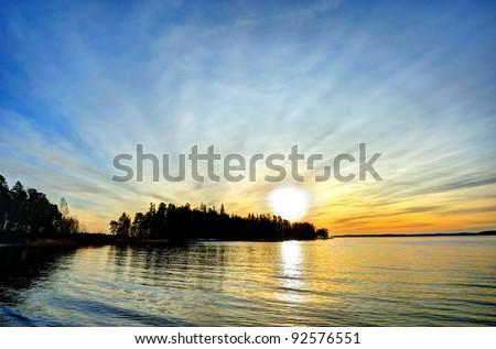 Winter sun setting down (Turku, Finland) - stock photo