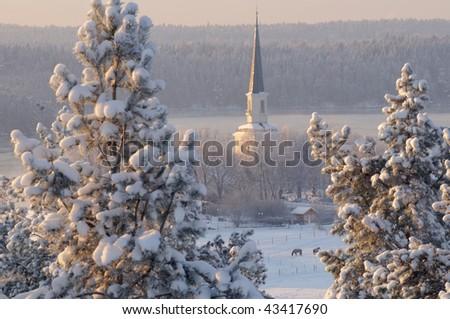 Winter sundown church