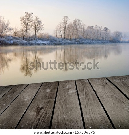 Winter sunrise and empty wooden deck table. Ready for product montage display.