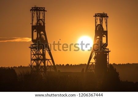 Winter sunrise captured between what was the tallest colliery headstocks in Europe, Clipstone Colliery. Closed in 2003, the mine still leaves a dramatic mark on the landscape. Silhouetted by the sun.