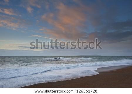Winter sunrise over low tide beach