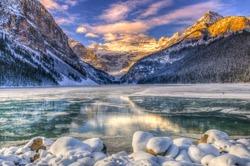 Winter sunrise over scenic Lake Louse in Banff National Park, Alberta Canada