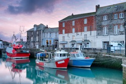 Winter sunrise overfishing boats at Padstow harbour on the north coast of Cornwall