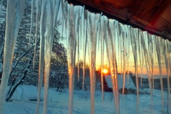 Winter sunrise scene with hanging icicles