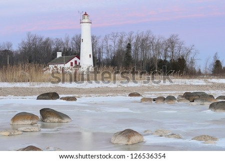 Winter sunrise Sturgeon Point Lighthouse Harrisville, Michigan USA