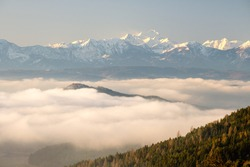 Winter sunrise with cloud inversion over the Kamnik alps, border of Slovenia and Austria from Magdalensberg