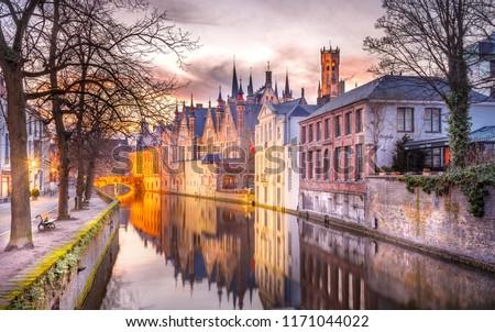 winter sunset in Bruges, Belgium #1171044022