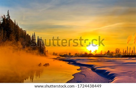 Winter sunset nature landscape. Sunset winter scene. Winter sunset rural landscape. Rural winter sunset landscape