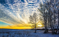 Winter sunset nature sky clouds landscape. Sunset sky clouds in winter. Winter sunset sky clouds view