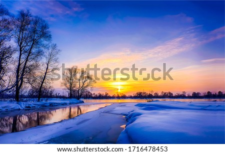 Winter sunset river snow landscape. Winter sunset nature scene. Sunset winter snow river landscape. Winter sunset snow nature