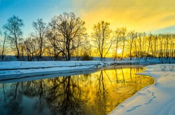 Winter sunset rural river landscape. Sunset river in winter scene