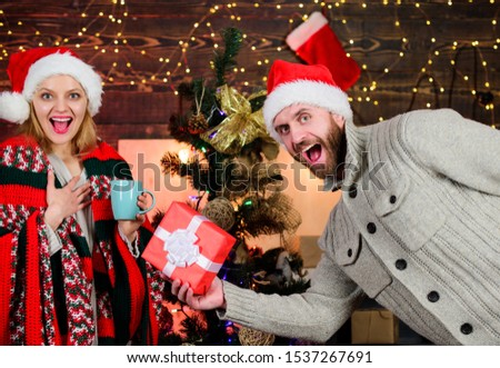 Winter surprise. Man giving gift box. Christmas surprise concept. Giving and sharing. Generosity and kindness. Surprising his wife. Prepare surprise for darling. New year tradition. Guess her desire.