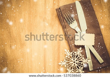 Winter Table Setting Silverware With Empty Tag And Linen Napkin On Rustic Wooden Background