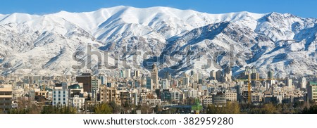 Winter Tehran view with a snow covered Alborz Mountains on background. Panorama Stock fotó ©