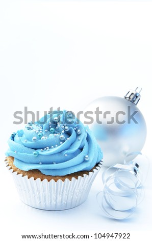 Winter theme blue silver cup cake with christmas bauble and ribbon
