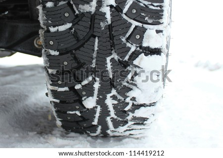 winter tire in snow closeup