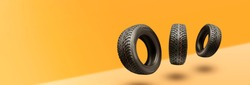 winter tires - panoramic concept with copyspace for the site header on a bright orange background. sale of tires or spare parts for the car.