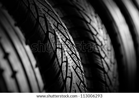 Winter Tires stack background. Selective focus.