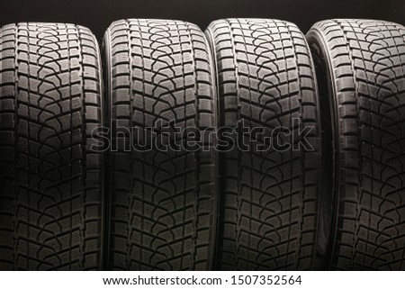 winter tires Velcro without spikes friction, used, close-up on a black background. slats and grooves. safe riding in winter, Chinese production #1507352564