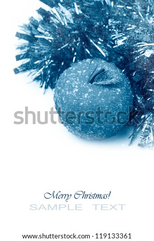 Winter toned christmas image with decorations over white background - stock photo
