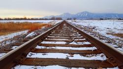 Winter Train Tracks and Boulder Flatiron Mountains