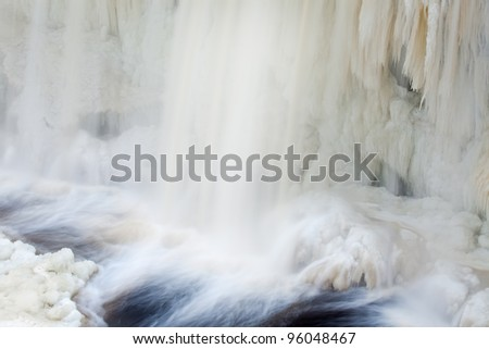 Winter, Upper Tahquamenon Falls framed by ice and captured with motion blur, Michigan's Upper Peninsula, USA
