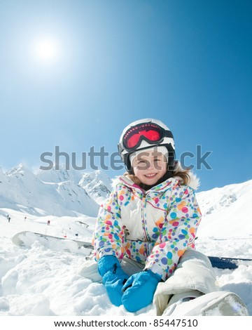Winter vacation, ski - happy skier playing in snow (copy space)