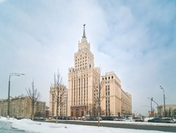 Winter view of neo-classical Stalin-era high-rise building on Red Gate Square, Garden Ring road in Moscow. Russia. Copy space