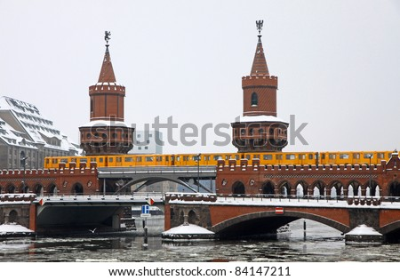 Winter view of Oberbaumbrucke bridge across the Spree river in Berlin, Germany. Is the longest bridge of Berlin