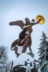 Winter view of the bronze sculpture of the Archangel Michael in Kiev on vladimirs mountain