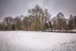 winter view of the white Vondelpark under the snow in Amsterdam