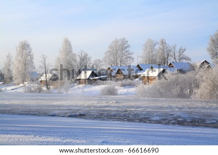 winter village on coast river