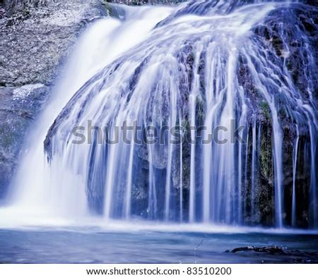 Winter waterfalls in mountains. - stock photo