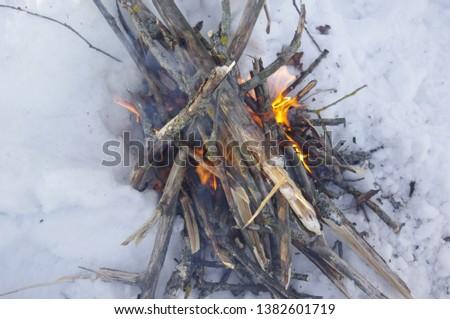 Winter winter winter bonfire in the snow