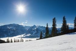 winter with ski slopes of kaprun resort next to kitzsteinhorn peak in austrian alps